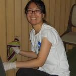 Kinesiske Lin vasker inne under sommerdugnaden 2014 på Salen